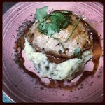 Dos gardenias. A center cut pork chop stuffed with proccioutto and manchego cheese over a parmes