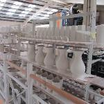 Racks of drying pottery