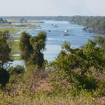View of Chobe river with safari boats, seen from game vehicle