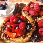 french toast with roasted hazelnuts and fresh berries