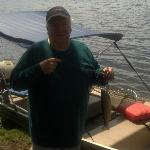 My grandpa with a 12 inch rainbow trout he caught