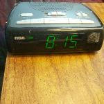 dust on alarm clock as well as whole room