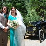 Wedding photo of us in front of vintage Model T Ford.