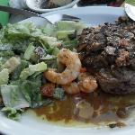 Grey steak..gristle..blood and grease on Caesar salad...YUCH!!