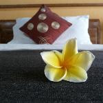 Beautiful fresh flowers on the beds when you arrive