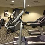 workout room. note tvs on cardio equipment, a nice cord weight machine, and a bottle fill water