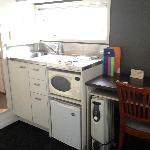 The kitchenette (includes fridge, hotplate and microwave) and window.