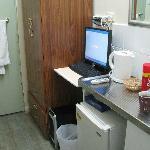 sink, fridge and desk-top Computer