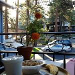 enjoying a beautiful summer morning with fresh continental breakfast at the bistro table right o