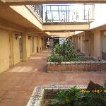 The shaded patio area for the first floor rooms