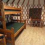 Beds and table. There is a futon on the other side.