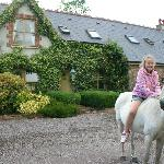Zoe having a pony ride a the Cottage
