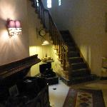 The hall and stairs leading up to the guest rooms
