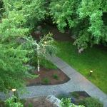 Looking down from 3rd floor balcony to creekside patio/path/lawn