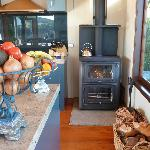 Wood burner in kitchen