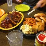 Dinner for five: ribs, brisket, pulled pork, hot wings and sides