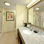 Spacious Showers, rich vanities and bright bathroom lights