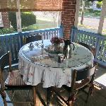 Breakfast setting on screened frront porch