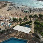 View from room of pool area, bar next door & beach