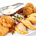Part of the El-Phoenician Banquet. from left, cauliflower, lamb pastries (sambousik) & falafel