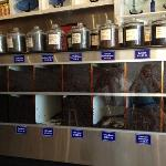 Variety of coffee beans for sale, including pure extra fancy Kona.