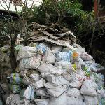 heaps of bags of rubble and rubbish in the former garden