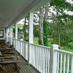 First floor suite opens out onto back porch with view of the water and adirondiak chairs