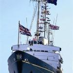 Royal Yacht Britannia, now berthed in Edinburgh, with her dress flags flying in the wind.