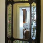 The hallway mirror that looks into the kitchen