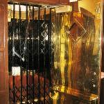 The elevator - heavy brass door to hold open, gate to open