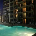 Comfort Inn & Suites at night by the outdoor pool.
