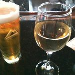 frosty honey weiss & glass of Pino at the bar