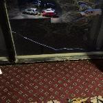 broken exterior window in a hallway