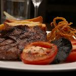 28 day aged Dedham Vale rib-eye steak, slow baked tomatoes, mushroom, hand cut chips & crispy on