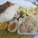 Some kind of white fish with shrimp, dill, horseradish, and egg in a beurre blanc sauce