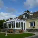 Pinewood and its sunny, south facing conservatory/dining room with sea views