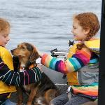 Small children and dog on the bow.