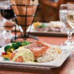 Fresh Salmon Filet of the Day - served with starch and vegetable.