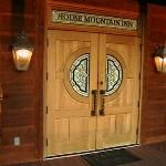 Front doors - use as main entrance. Locked at 9 PM.