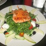 My entree: a garden salad with grilled salmon, goat cheese, sliced pears and kalamata olives.