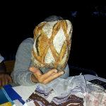 My wife hiding behind fabulous bread