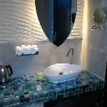 basin area with fridge underneath