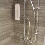 Inside the shower. Fittings clean and functional, wonderful styling and lighting. Soap supplied.
