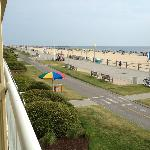 Ocean front view from balcony looking down boardwalk and bike path