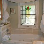Lovely bathroom with whirlpool tub, extras like cotton swabs and bath robes!