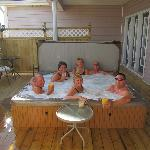Guests enjoying a drink in the 7 person Hot tub