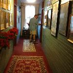 The hallway and my husband going into our room. Lots of historical pictures throughout the B&B.