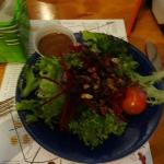 house salad with raw beet shreds and toasted pecans