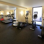 Fitness center complete with free weights and exercise mat area