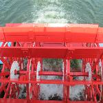 The paddle wheel churning through the water.